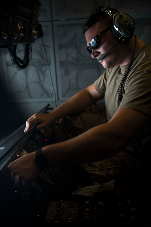 """Senior Airman Richard Walker, 908th Expeditionary Air Refueling Squadron boom operator, prepares the boom to refuel an Israeli Air Force F-35I Lightning II """"Adir"""" as it approaches a KC-10 Extender during """"Enduring Lightning II"""" exercise over Israel Aug. 2, 2020. While forging a resolute partnership, the allies train to maintain a ready posture to deter against regional aggressors. (U.S. Air Force photo by Master Sgt. Patrick OReilly)"""