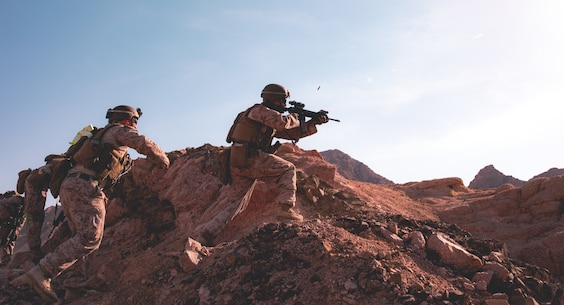 U.S. Marines conduct fire and maneuver during a fire team assault range in Jordan, July 31.