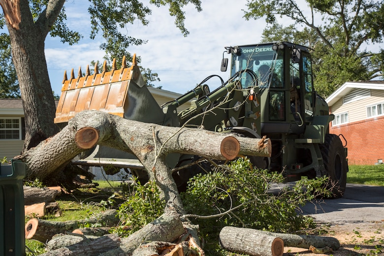U.S. Marine Corps Lance Cpl. Anderson Rojas, with 8th Engineer Support Battalion, 2nd Marine Logistics Group, clears debris at Berkley Manor on Marine Corps Base Camp Lejeune, North Carolina, Aug. 4, 2020. U.S. Marines carried out recovery efforts after Hurricane Isaias in order to resume normal operations while following COVID-19 mitigation guidelines. (U.S. Marine Corps Photo by Lance Cpl. Isaiah Gomez)
