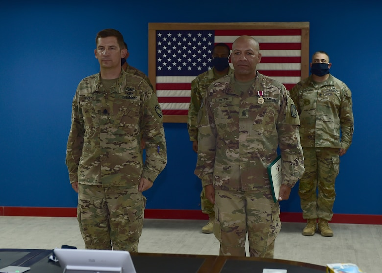 U.S. Army CSM Seagram Porter, outgoing command sergeant major, relinquishes responsibility of the 4-5 Air Defense Artillery Regiment to CSM Tomas Barrios during a Change of Responsibility Ceremony at Prince Sultan Air Base, Kingdom of Saudi Arabia.