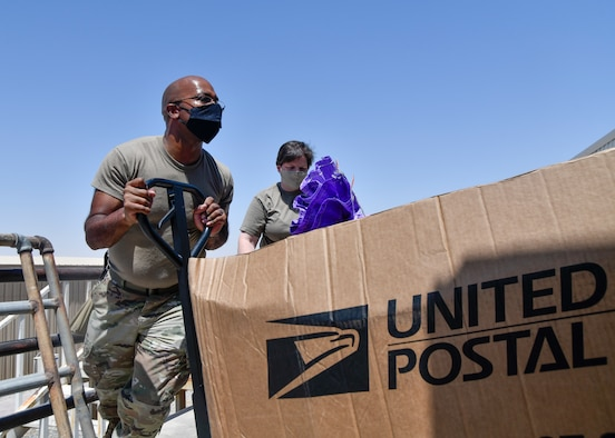 Airmen unload mail from truck