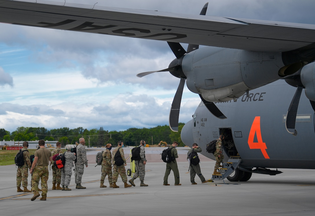 Airmen assigned to the 158th Fighter Wing, Vermont Air National Guard, deploy to Volk Field, Wisconsin, for Operation Northern Lightning, Vermont Air National Guard Base, South Burlington, Vt., Aug. 3, 2020. A C-130 assigned to the 146th Airlift Wing, Channel Islands Air National Guard Station, California Air National Guard, flew the Green Mountain Boys to partake in a two-week exercise where they will train on combat operations involving the F-35A Lightning II.