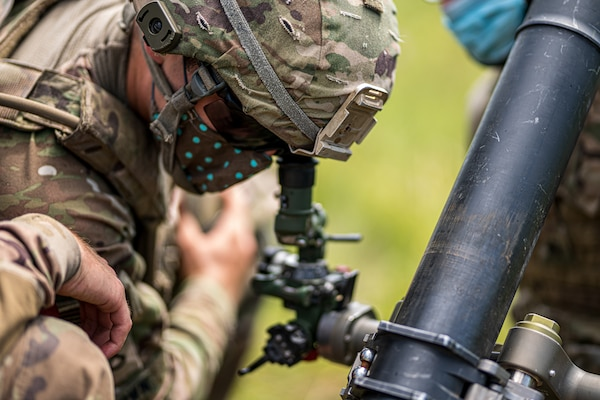 During an integrated live-fire, Indiana National Guard Soldiers with the 76th Infantry Brigade Combat Team's 151st Infantry Regiment completed mortar table five, a practice qualification exercise, at Camp Atterbury, Edinburgh, Indiana, July 21, 2020.