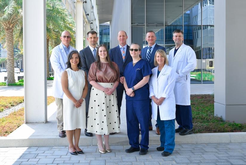 Members of the initial Trauma, Burn, and Rehabilitative Medicine team (TBRM) pose for a team photo.