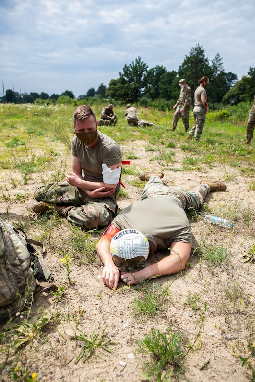 Spc. Quinn Perro of the 32nd Infantry Brigade Combat Team portrays a casualty mourning the death of his fallen comrade, Ssg. Robert Grinage at Collective Training Center - Yavoriv, Ukraine July 27.