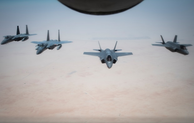 A formation of U.S. Air Forces Central Command F-15C Eagles and F-35A Lightning IIs fly behind a U.S. Air Force KC-135 Stratotanker during air refueling over Southwest Asia, July 25, 2020. Through joint exercises or direct operations, the 380th Air Expeditionary Wing continues to strengthen relationships with regional and coalition partners to defend the region. (U.S. Air Force photo by Master Sgt. Larry E. Reid Jr.)