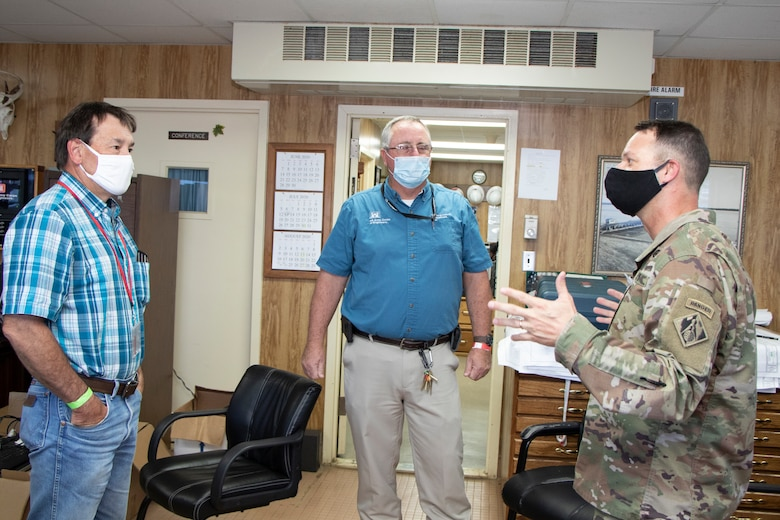 U.S. Army Corps of Engineers (USACE) Vicksburg District Commander Col. Robert Hilliard (right) speaks with River Operations employees Ed Adcock (center) and Barry Sullivan ahead of the Mat Sinking Unit's deployment July 21.