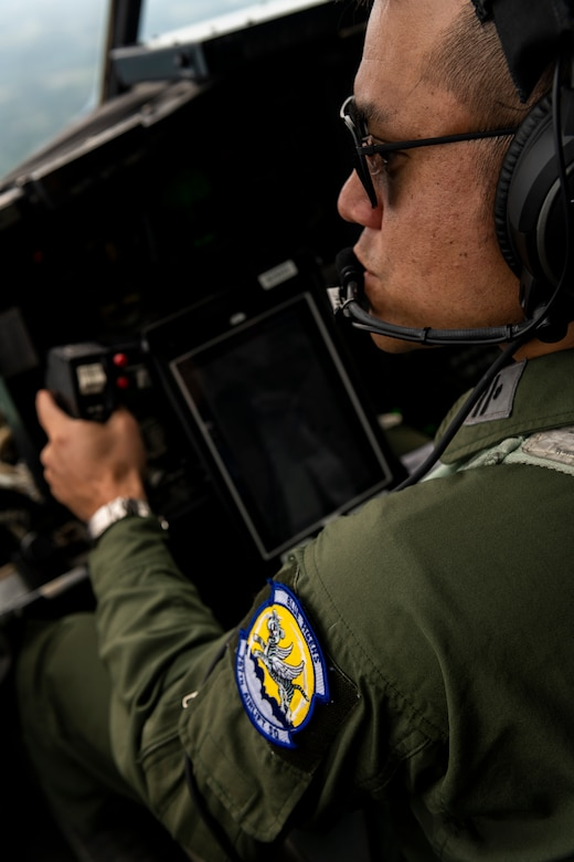 Maj. Kazunori Takahara, a pilot with the Japan Air-Self Defense Force's 1st Tactical Airlift Wing, flight commands a 757th Airlift Squadron C-130H Hercules aircraft, July 22, 2020, over Northeast Ohio. Takahara is a participant in the Defense Personnel Exchange Program, where he will spend two and a half years assigned to the United States Air Force's 910th Airlift Wing. The DPEP is designed to nurture the bonds of friendship and understanding that exist between the two air forces through the exchange of ideas and tactics by the members of each service.