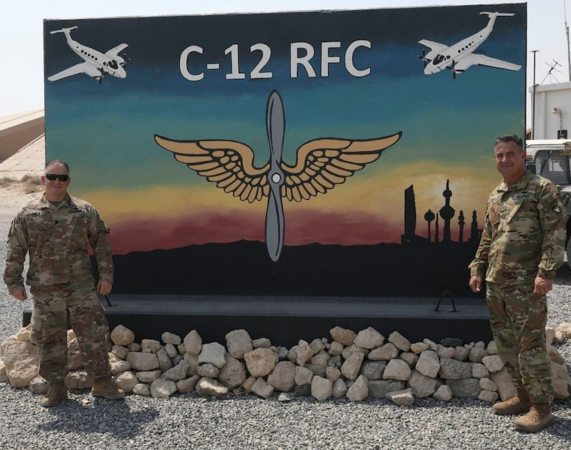Lieutenant Colonel Bailie, Task Force Spartan's Aviation Section Chief, visited the 34th Expeditionary Combat Aviation Brigade at the C-12 Regional Flight Center and met with Chief Warrant Officer Five Dukes.    The visit allowed for discussions on flight missions, possible partnership opportunities with friends and allies in the region, and how to best improve aviation practices and procedures.