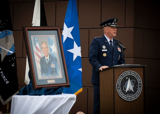"Gen. John W. ""Jay"" Raymond, U.S. Space Force Chief of Space Operations and Commander, U.S. Space Command, addresses attendees during the Gen. Moorman Tribute ceremony at the Moorman Education and Training Center at Peterson Air Force Base, Colorado, Aug. 3, 2020."