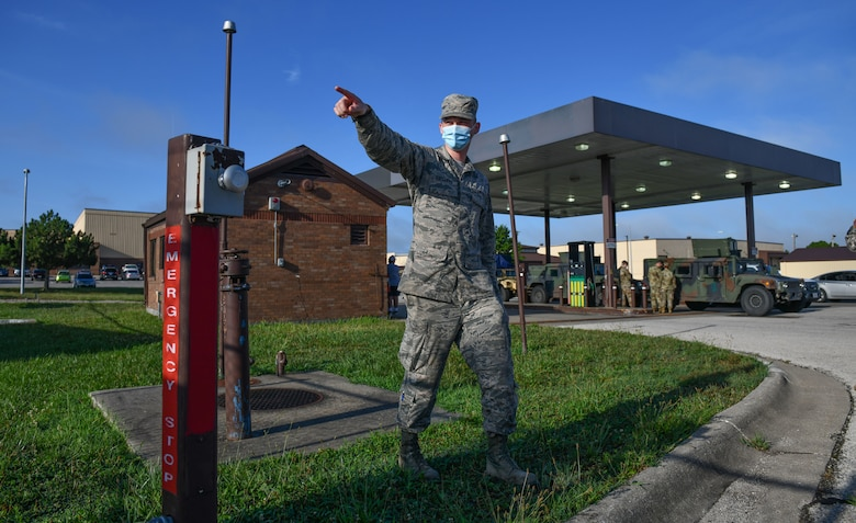 Staff Sgt. Justin Ratcliffe,  an NCO in charge of fuels fixed facilities with the 509th Logistics Readiness Squadron, points to safety valves and introduces students to safety measures and procedures at a government vehicle fuel station at Whiteman Air Force Base, Missouri, July 22, 2020. The introduction to the station and its fuel spill mitigation measures was part of a Defense Logistics Agency and 509th Civil Engineer Squadron  spill response and mitigation course. (U.S. Air Force photo by Tech. Sgt. Alexander W. Riedel)