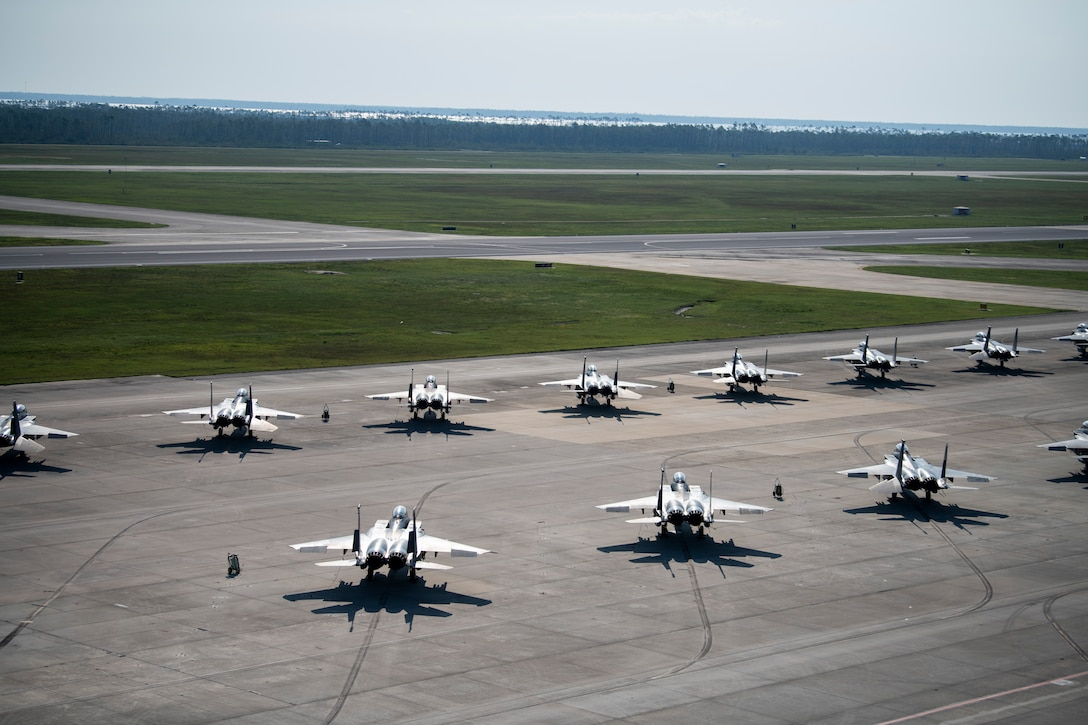 Numerous F-15Es sit on the runway.