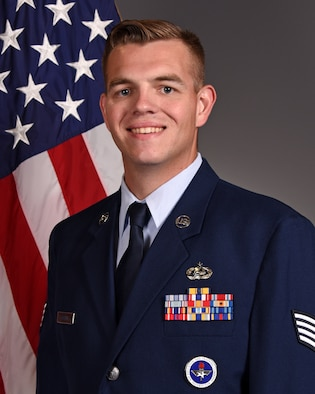 U.S. Air Force Staff Sgt. Austin Gooding poses for his official photo at the photo studio on Goodfellow Air Force Base, Texas, July 30, 2020. (Courtesy photo)