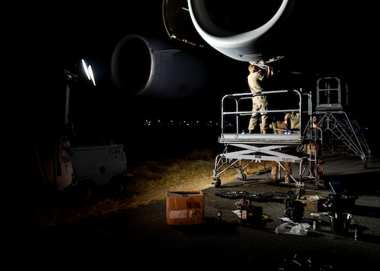Tech. Sgt. Byron Hand, 5th Expeditionary Air Mobility Squadron aerospace propulsion craftsman, works on a Canadian C-17A Globemaster III engine.