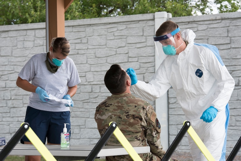 167th Medical Group personnel conduct a COVID-19 swab test for an Airman over the August unit training assembly. All base personnel are to be tested for the coronavirus by the end of September.