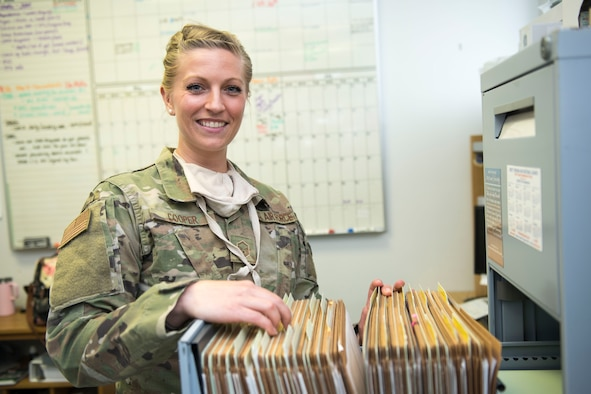 Master Sgt. Jennifer Cooper, NCOIC Public Health, 167th Medical Group, searches for a file in her office, at the 167th Airlift Wing, Martinsburg, W. Va., June 11, 2020. Disease prevention is the core function of her office.