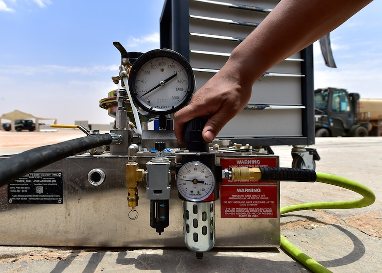 Airmen from the 378th Expeditionary Logisitcs Readiness Squadron perform a hydrostatic test on fuel hoses at Prince Sultan Air Base, Kingdom of Saudi Arabia.