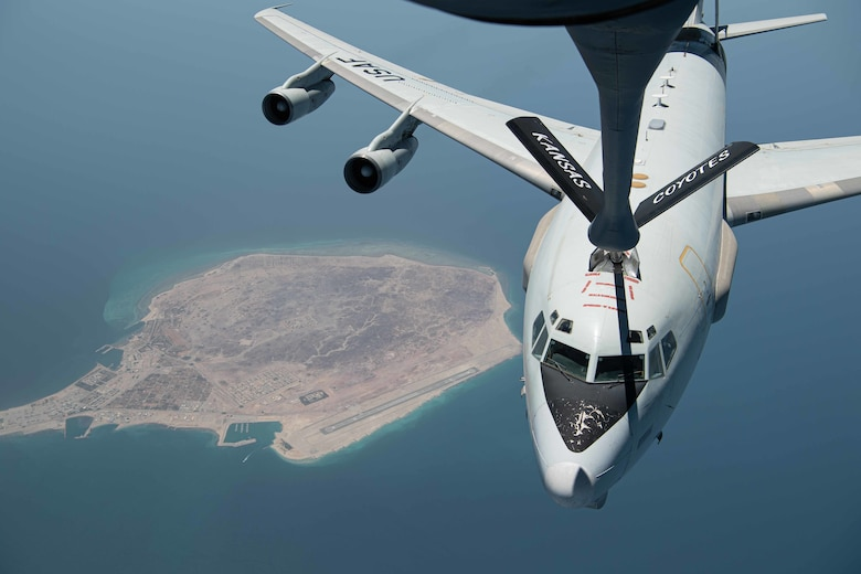 U.S. Air Force Airmen assigned to the 340th Expeditionary Air Refueling Squadron conduct an air refueling mission aboard a U.S. Air Force KC-135 Stratotanker with a U.S. Air Force E-3 Sentry, assigned to the 968th Expeditionary Airborne Air Control Squadron on July 25, 2020. Through joint exercises or direct operations, the 380th Air Expeditionary Wing continues to strengthen relationships with regional and coalition partners to defend the region. (U.S. Air Force photo by Staff Sgt. Justin Parsons)