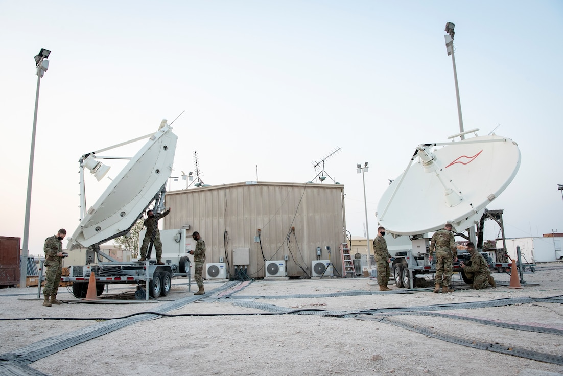 U.S. Air Force Airmen from the 16th Space Control Squadron, perform routine maintenance operations on satellite dishes at Al Udeid Air Base, Qatar, July 30, 2020. Operation Silent Sentry protects critical satellite communication links by employing multiple weapons systems for space electronic warfare. (U.S. Air Force photo by Tech. Sgt. Michael Battles)