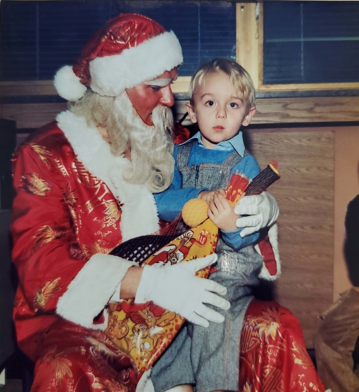 Tech. Sgt. Muris Secerbegovic, 433rd Maintenance Group quality assurance inspector, as a child with Santa Claus in Banja Luka, Bosnia-Herzigovina.