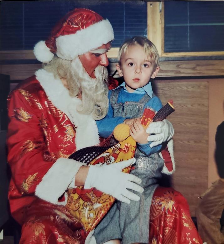 Tech. Sgt. Muris Secerbegovic, 433rd Maintenance Group quality assurance inspector, as a child with Santa Claus in Banja Luka, Bosnia-Herzigovina.
