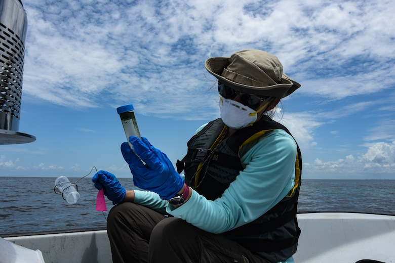 The U.S. Army Engineer Research and Development Center's Research Community Planner, Angela Urban, collects blue green algae samples and data on Lake Okeechobee, Fla., July 27, 2020.