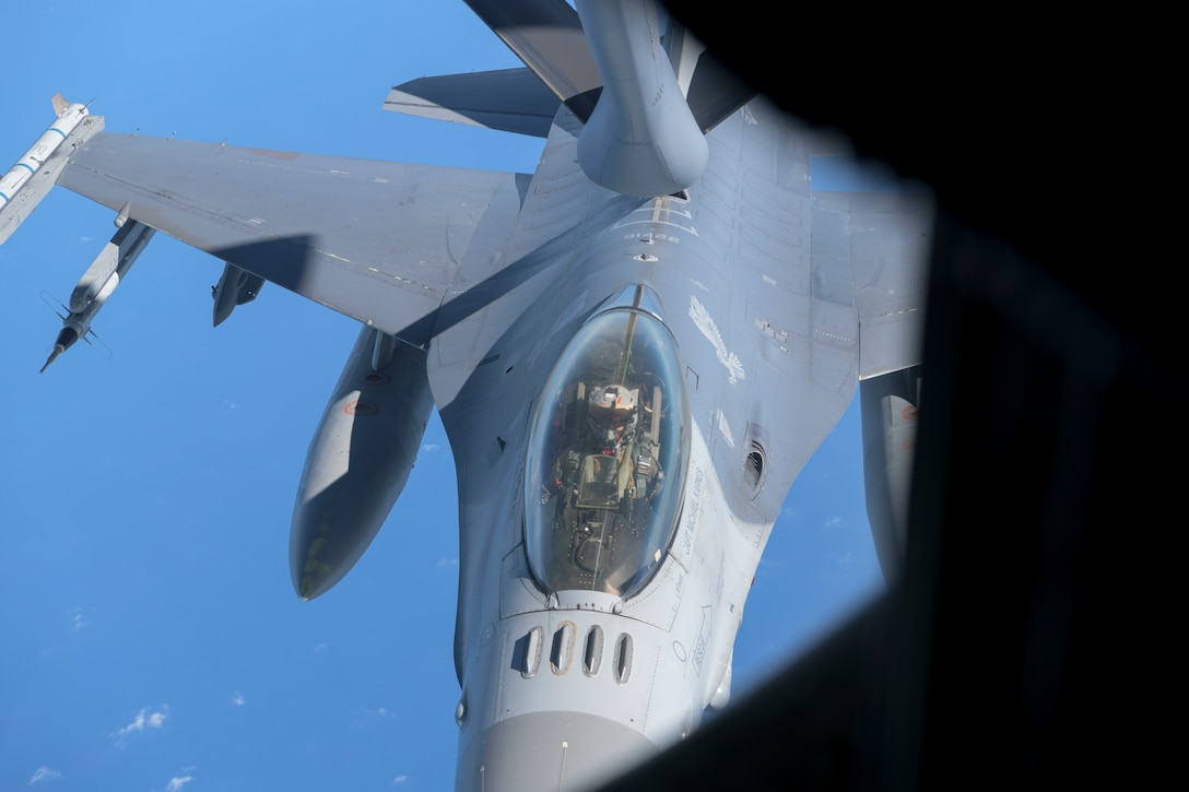 U.S. Air Force F-16 Fighting Falcon from the 35th Fighter Wing, Misawa Air Base, Japan, is being refueled by a KC-135 Stratotanker from the 909th Air Refueling Squadron during the second iteration of Exercise WestPac Rumrunner, July 31, 2020, at Kadena Air Base, Japan. The National Defense Strategy (NDS) directs the U.S. military to be more lethal, improve relationships with allies and partners, and encourage institutional reform; the 18th Wing supports the NDS by developing and continuing new training exercises like WestPac Rumrunner.
