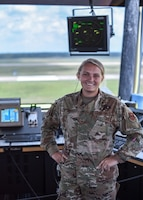 Senior Airman Miranda Fisher, 14th Operations Support Squadron Air Traffic Controller, poses for a photo August 4, 2020, on Columbus Air Force Base, Miss. The new Tower Coordinator position is vital in ensuring even safer and overall improved communication between controllers and from the tower to the pilots. (U.S. Air Force photo by Senior Airman Keith Holcomb)