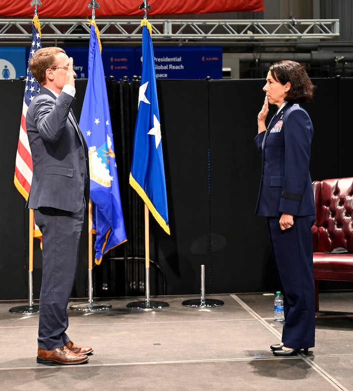 Brig. Gen. Jeannine Ryder swears an oath for the first time as a newly-promoted general officer, Aug. 3 at the National Museum of the United States Air Force, Wright-Patterson Air Force Base, Ohio. (photo by Darrius Parker)