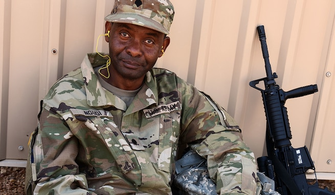 Spc. Gerald Ngugi, a light-wheeled mechanic with 2nd Space Battalion, 1st Space Brigade, Colorado Springs, Colo., takes a break after qualifying at a weapons range at Fort Carson, Colo., Aug. 1, 2020. (U.S. Army photo by Staff Sgt. Aaron Rognstad)