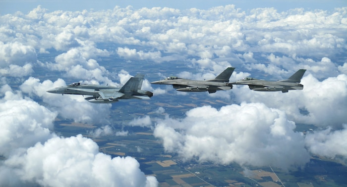 Royal Canadian Air Force CF-18 and United States Air Force F-16s participate in binational NORAD air defence exercise conducted over the Greater Toronto Area on July 30, 2020.(Photo courtesy of CANR Public Affairs)