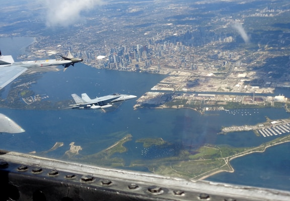 Royal Canadian Air Force CF-18 Hornets participate in binational NORAD air defence exercise over the Greater Toronto Area (GTA) on July 30, 2020.
