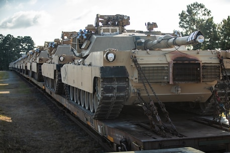 U.S. Marine Corps M1A1 Abrams tanks with 2d Tank Battalion, 2d Marine Division (MARDIV) sit on railroad cars prior to a farewell ceremony on Camp Lejeune, North Carolina, July 31, 2020. Marines with 2d Tank Battalion bid their final farewell after nearly 80 years of service to 2d MARDIV in accordance to the future redesign of the Marine Corps. (U.S. Marine Corps photo by Lance Cpl. Patrick King)