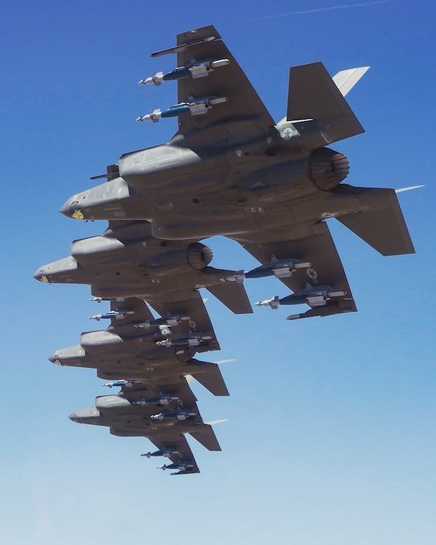 Four F-35A Lightning IIs, assigned to the 63rd Fighter Squadron, fly in formation during a training sortie over Arizona, Aug. 9, 2019.