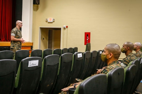 The 19th Sergeant Major of the Marine Corps, Sgt. Maj. Troy E. Black addresses the Marines attending the Drill Instructor School at Marine Corps Recruit Depot (MCRD) Parris Island, South Carolina, July 22, 2020. During the visit Sgt. Maj. Black toured the training facilities to observe changes made keep recruits and Drill Instructors safe during COVID-19 restrictions. The changes include the use of face masks when less than six feet apart, and smaller platoon sizes in addition to the 14 days of restriction of movement before new recruits start training. (U.S. Marine Corps photo by Sgt. Victoria Ross)