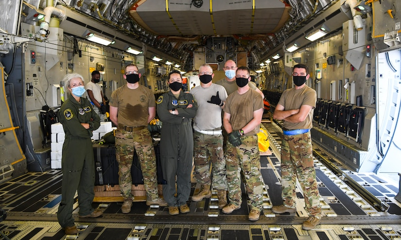 Airmen who are part of the NASA human space flight loadmaster team assigned to the 144th Airlift Squadron, Joint Base Elmendorf-Richardson, Alaska pose for a photo after loading a Joint Base Charleston C-17 Globemaster III for launch July 31st, 2020 at the JB Charleston flightline, S.C. C-17s from JB Charleston are a part of the NASA human space flight program. As a precautionary measure, U.S. Space Command and the U.S. Air Force assigned teams of search and rescue professionals to stand alert ahead of the launch at Joint Base Charleston, South Carolina; Patrick Air Force Base, Florida; and Joint Base Pearl Harbor-Hickam, Hawaii. The teams are comprised of Pararescuemen, Combat Rescue Officers, and Aircrew Flight Equipment specialists.