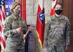 Lt. Gen. Laura J. Richardson (left), U.S. Army North Commanding General,presents Chief Warrant Officer 4 Laura Ingraham, an aviation safety officer assigned to U.S. Army North, with the honorable Order of St. Michael bronze medal at Joint Base San Antonio-Fort Sam Houston Aug. 4. The Order of St. Michael is an Army Aviation Association of America award presented to nominated Army aviators who make a significant contribution to their field and highly demonstrate the Army Values.