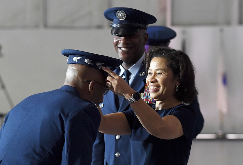 Sharene Brown, spouse of incoming Air Force Chief of Staff Gen. Charles Q. Brown Jr., presents the official Air Force Chief of Staff service cap to her husband during the CSAF transition ceremony at Joint Base Andrews, Md., Aug. 6, 2020. Brown is the 22nd Chief of Staff of the Air Force. (U.S. Air Force photo by Staff Sgt. Chad Trujillo)