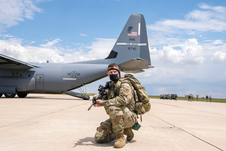 Airman with gun defending the aircraft area