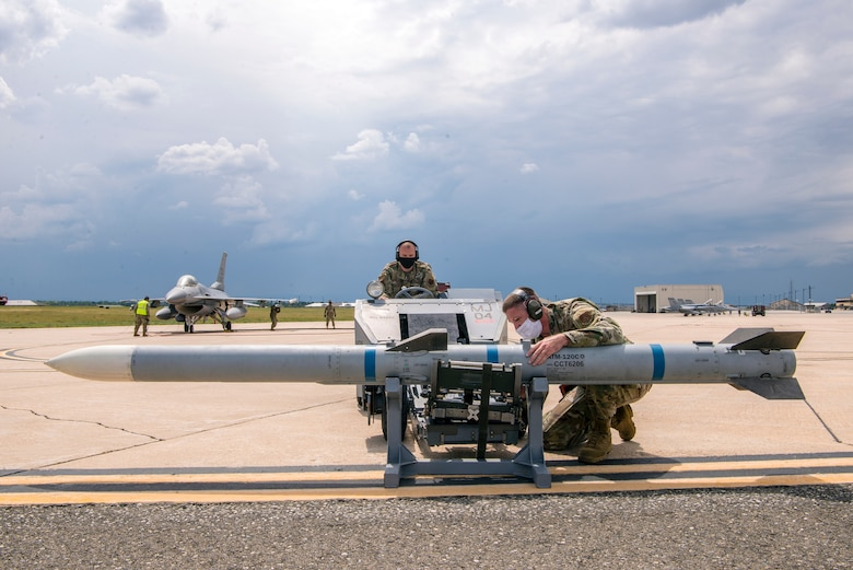 Two Airmen with a jammer and missile