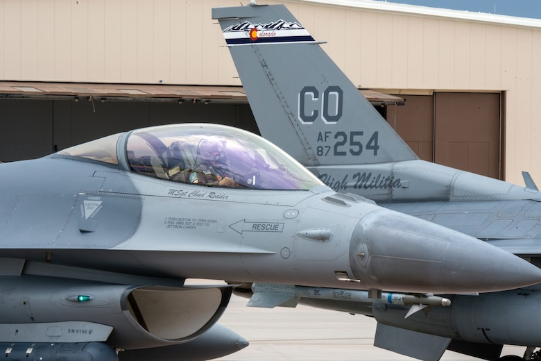 Pilot in cockpit preparing for take off