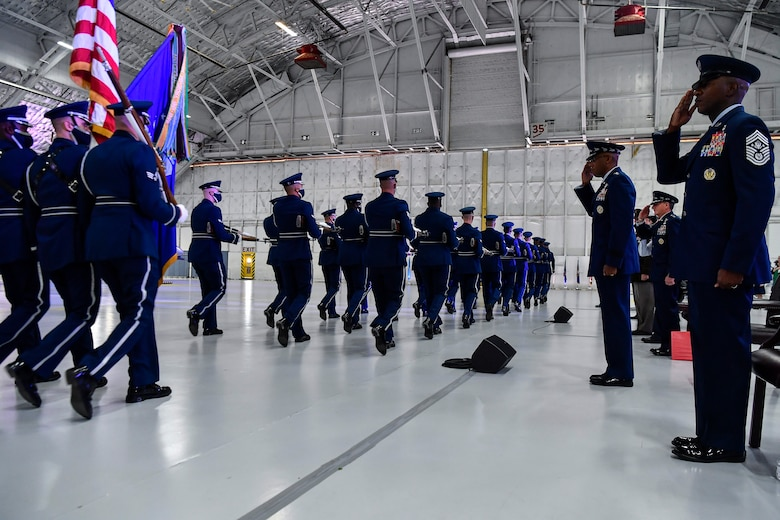 The Air Force Honor Guard performs a pass in review in front of Air Force Chief of Staff Gen. Charles Q. Brown Jr. during a transition ceremony at Joint Base Andrews, Md., Aug. 6, 2020. Brown replaced Gen. David L. Goldfein as the 22nd chief of staff. (U.S. Air Force photo by Eric Dietrich)