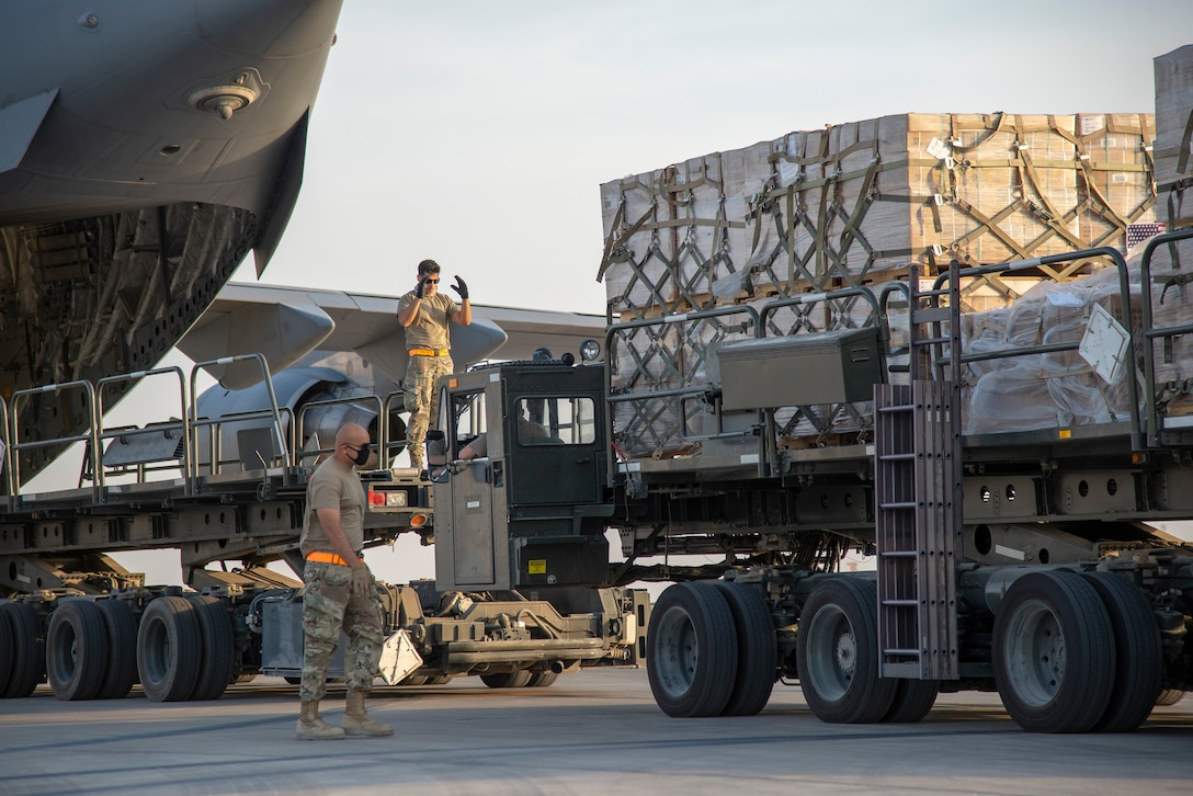 U.S. Air Force Airmen load humanitarian aid supplies a U.S. Air Force C-17 Globemaster III at Al Udeid Air Base, Qatar, Aug. 6, 2020, bound for Beirut, Lebanon. U.S. Central Command is coordinating with the Lebanese Armed Forces and U.S. Embassy-Beirut to transport critical supplies as quickly as possible to support the needs of the Lebanese people. (U.S. Air Force photo by Staff Sgt. Heather Fejerang)