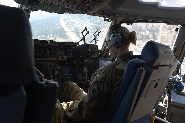 Col. Erin Staine-Pyne, 62nd Airlift Wing commander, prepares to land a C-17 Globemaster III on the McChord flight line, on Joint Base Lewis-McChord, Wash., Aug. 4, 2020. Training exercises such as Exercise Rainier War, allow opportunities for pilots to practice flight skills and log flight hours. (U.S. Air Force photo by Airman 1st Class Mikayla Heineck)