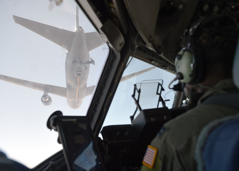 Capt. Edmond Duvall, 7th Airlift Squadron pilot, prepares to aerial refuel a C-17 Globemaster III from a KC-46 Pegasus from Fairchild Air Force Base, Wash., over Washington, Aug. 5, 2020. The KC-46 Pegasus is the Air Force's newest refueling aircraft and many pilots are still learning and being certified on how to conduct refueling.  (U.S. Air Force photo by Airman 1st Class Mikayla Heineck)