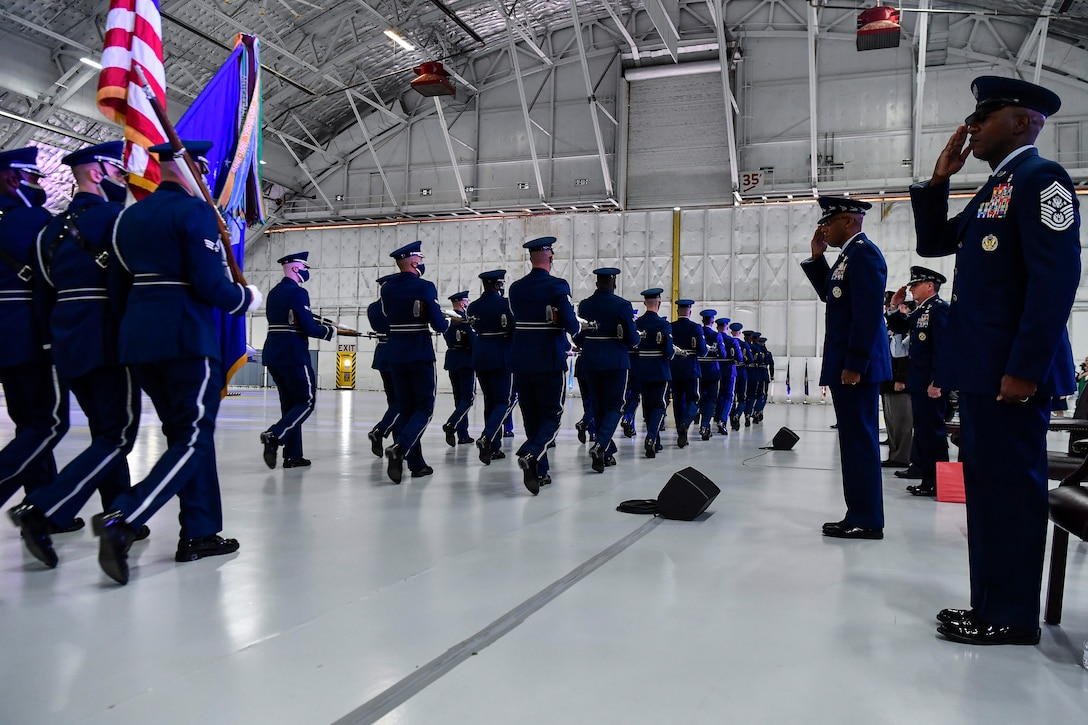 The Air Force Honor Guard performs a pass in review in front of Air Force Chief of Staff Gen. Charles Q. Brown Jr. during a change of responsibility ceremony at Joint Base Andrews, Md., Aug. 6, 2020. Brown replaced Gen. David L. Goldfein as the 22nd chief of staff. (U.S. Air Force photo by Eric Dietrich)