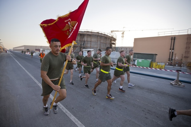 U.S. Marine Corps Sgt. Maj. Mario A. Marquez, sergeant major, Command Element Marine Forces Central Command Forward, runs with the unit colors during a command run on Naval Support Activity Bahrain Jan. 22, 2015. The run was conducted to boost morale and build camaraderie within the unit. (U.S. Marine Corps photo by CE MARFOR CENTCOM FWD Cpl. Sean Searfus/ Released)