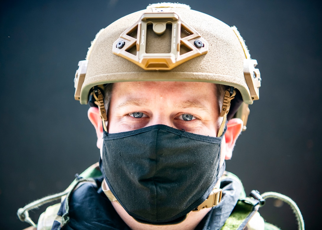 U.S. Air Force Tech. Sgt. Tyler Whaley, 423rd Civil Engineer Squadron dorm manager, wears mission oriented protective posture gear during a wing readiness exercise at RAF Alconbury, England, Aug. 5, 2020. The 501st Combat Support Wing conducted the exercise to evaluate Airmen's overall readiness along with their proficiency with responding to simulated chemical, biological, radiological, nuclear and explosive attacks. (U.S. Air Force photo by Senior Airman Eugene Oliver)