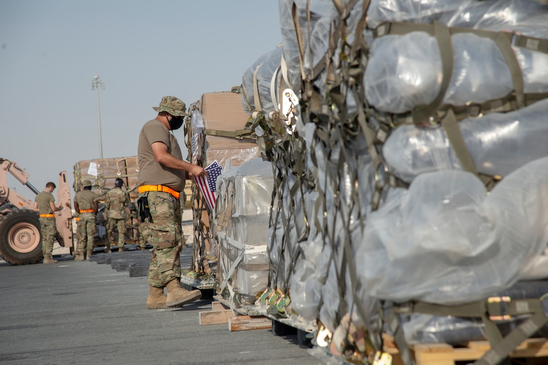 U.S. Air Force Airmen prepare to load humanitarian aid supplies onto a U.S. Air Force C-17 Globemaster III at Al Udeid Air Base, Qatar, Aug. 6, 2020, bound for Beirut, Lebanon. U.S. Central Command is coordinating with the Lebanese Armed Forces and U.S. Embassy-Beirut to transport critical supplies as quickly as possible to support the needs of the Lebanese people. (U.S. Air Force photo by Staff Sgt. Heather Fejerang)
