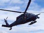 An Alaska National Guard 210th Rescue Squadron HH-60G Pave Hawk conducts hoist training June 5, 2018, at Eklutna Glacier.